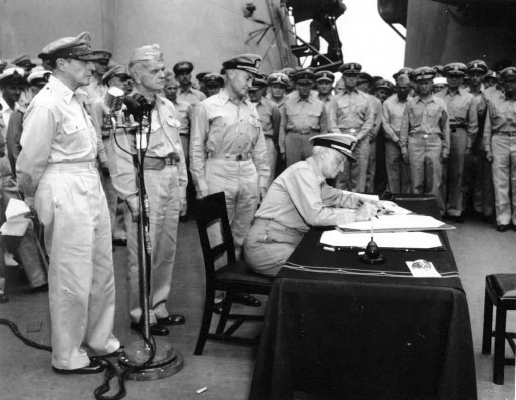 FILE- In this Sept. 2, 1945, file photo, Admiral Chester W. Nimitz, Commander-in Chief of the Pacific Fleet and Pacific ocean areas, sat at the table ...