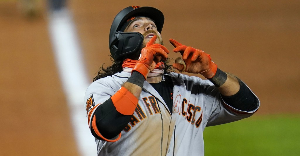 San Francisco Giants' Brandon Crawford gestures as he crosses home plate after hitting a three-run home run off Colorado Rockies relief pitcher Jairo ...