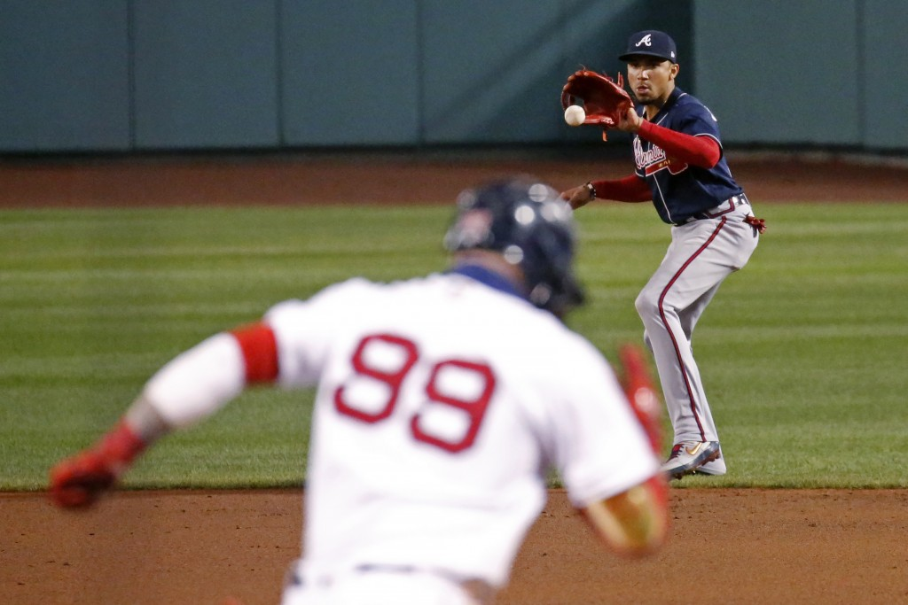 Boston Red Sox's Alex Verdugo (99) heads to first after hitting a grounder to Atlanta Braves second baseman Johan Camargo during the fifth inning of a...