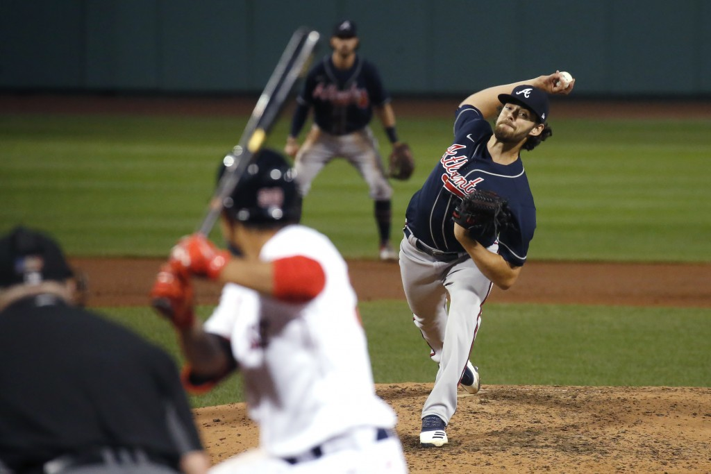Atlanta Braves starting pitcher Ian Anderson throws to a Boston Red Sox batter during the sixth inning of a baseball game Tuesday, Sept. 1, 2020, in B...