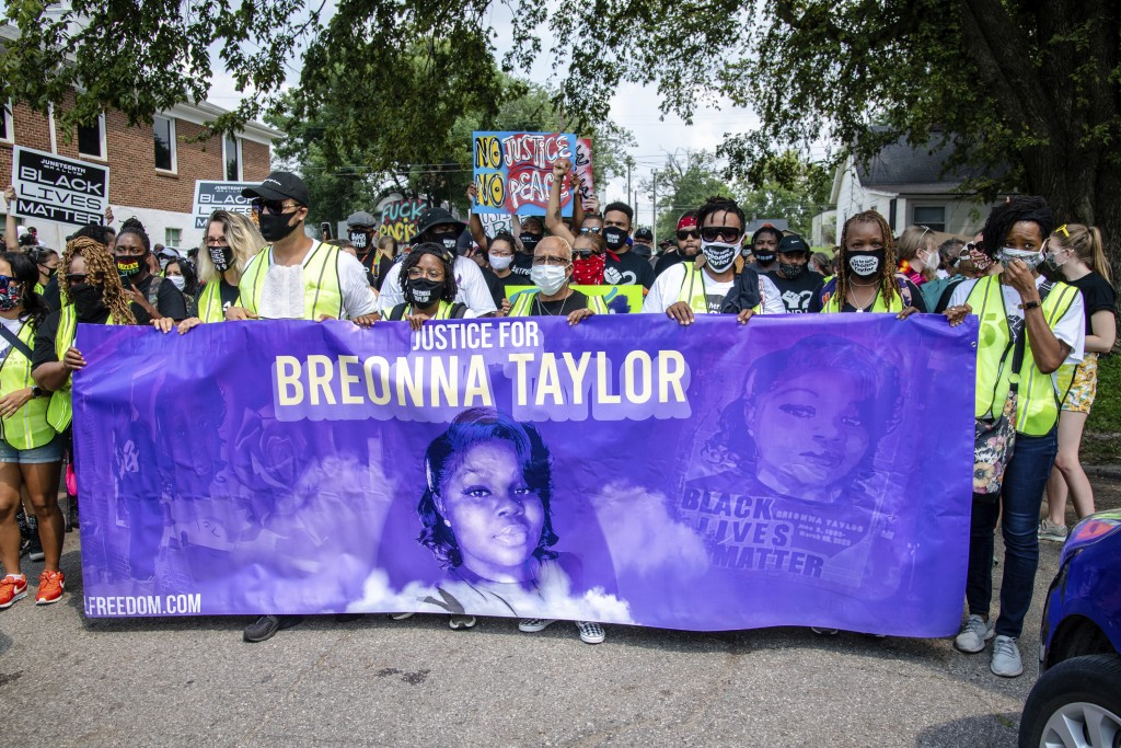 FILE - Protesters participate in the Good Trouble Tuesday march for Breonna Taylor, on Tuesday, Aug. 25, 2020, in Louisville, Ky.  A lawyer for Breonn...