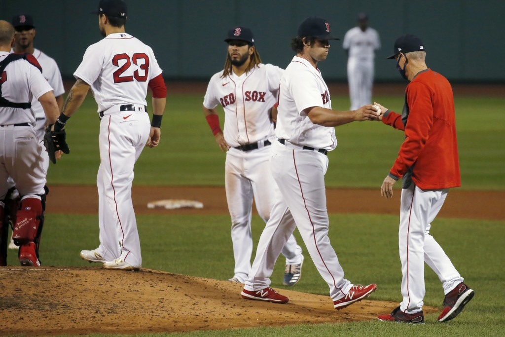 Boston Red Sox relief pitcher Robert Stock hands the ball over to manager Ron Roenicke as leaves the baseball game against the Atlanta Braves during t...