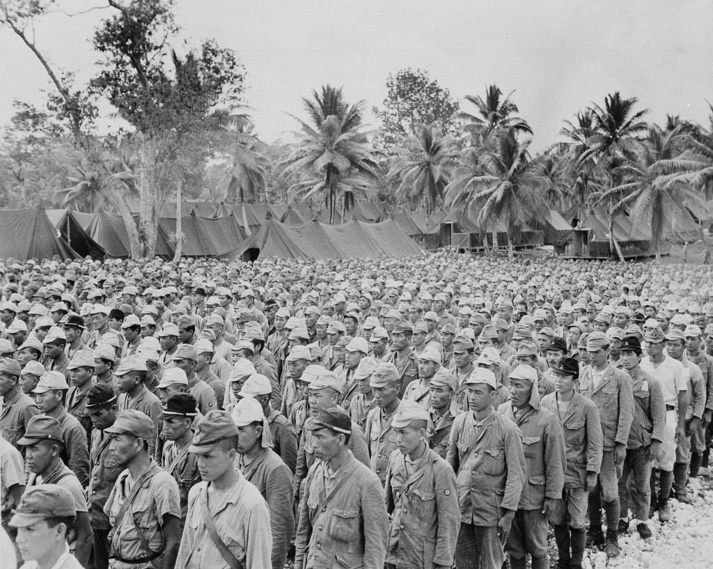 FILE - In this Sept. 5, 1945, file photo, part of 2,600 Japanese POWs, who comprised the enemy garrison on the island of Rota, are lined up in a priso...