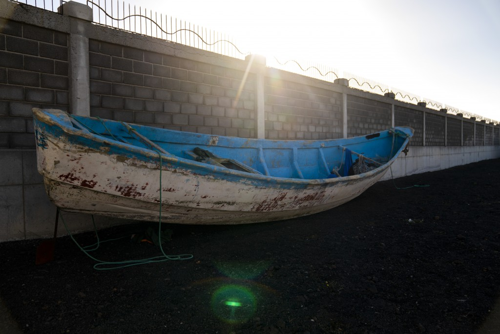 A wooden boat carrying the remains of migrant belongings is seen at the Arinaga port in Gran Canaria island, on Wednesday, Aug. 19, 2020. Some 4,000 m...
