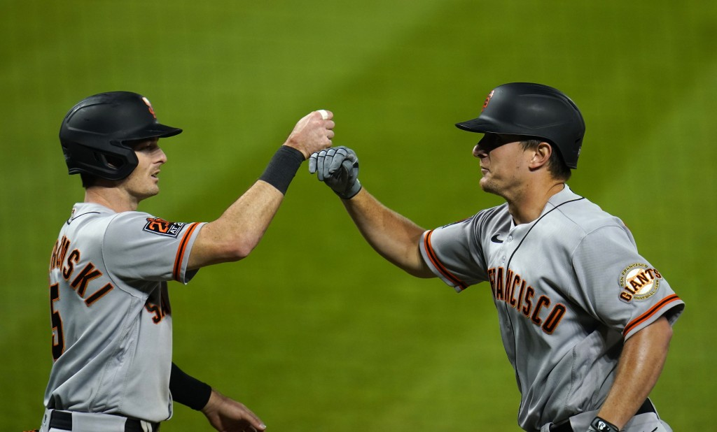 San Francisco Giants' Mike Yastrzemski, left, congratulates Alex Dickerson on Dickerson's three-run home run off Colorado Rockies relief pitcher Jairo...