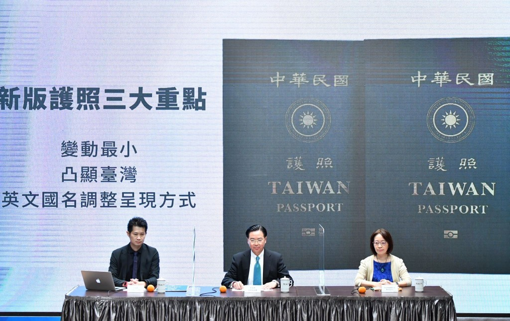 In this Sep. 2, 2020, photo released by the Executive Yuan, Taiwan's Foreign Minister Joseph Wu, center, and Executive Yuan spokesperson Evian Ting, l...