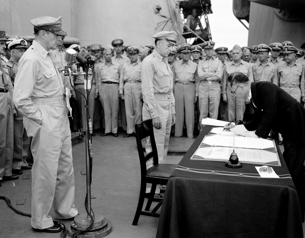 FILE - In this Sept. 2, 1945, file photo, U.S. General Douglas MacArthur, left, watches as the foreign minister Manoru Shigemitsu of Japan signs the s...