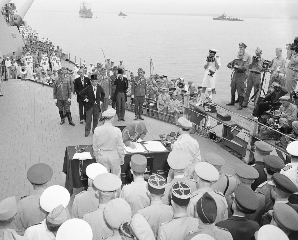 FILE - This Sept. 2, 1945, file photo show the scene aboard the battleship Missouri as the Japanese surrender documents were signed in Tokyo Bay. Wedn...