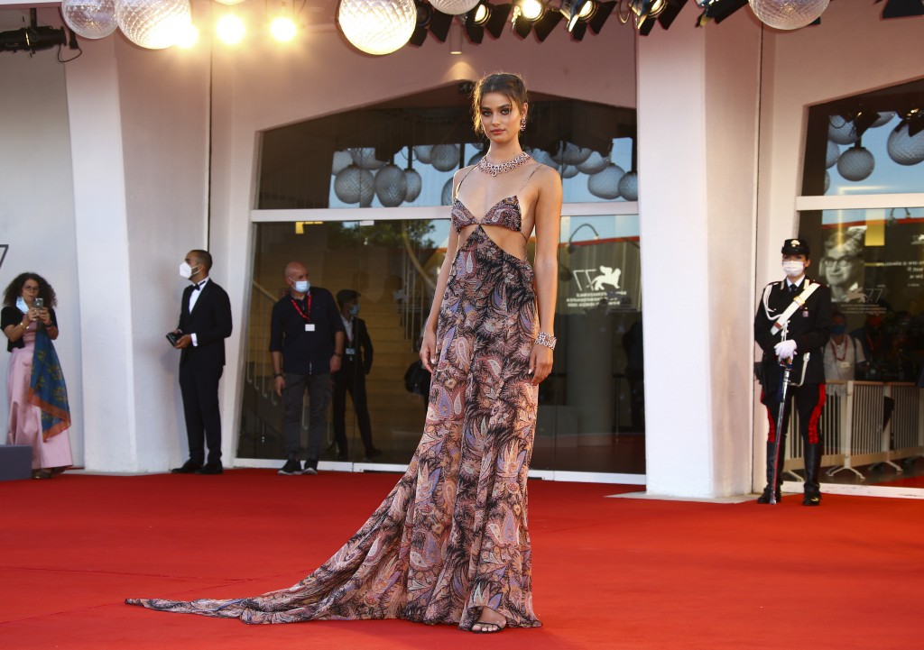 Model Taylor Hill poses for photographers upon arrival at the opening ceremony of the 77th edition of the Venice Film Festival in Venice, Italy, Wedne...