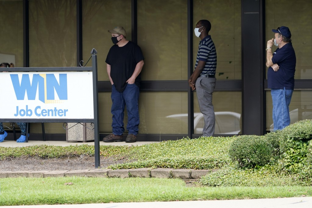 Clients line up outside the Mississippi Department of Employment Security WIN Job Center in Pearl, Miss., Monday, Aug. 31, 2020.  The U.S. economy's e...