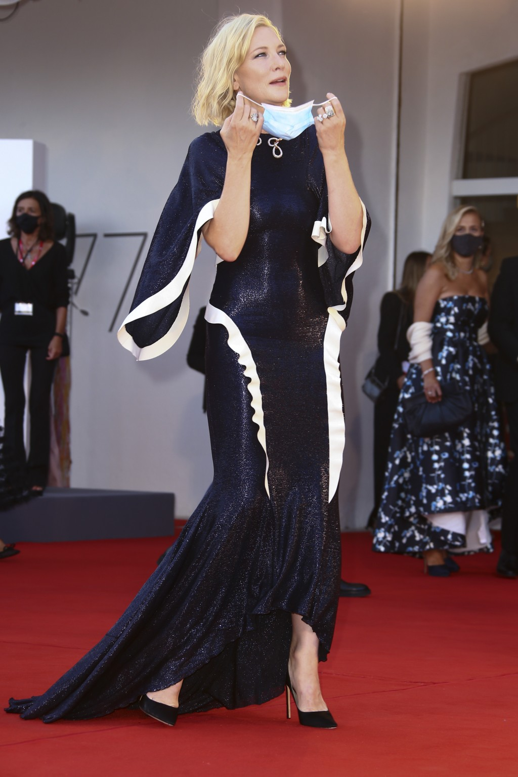 Jury president Cate Blanchett poses for photographers upon arrival at the opening ceremony of the 77th edition of the Venice Film Festival in Venice, ...