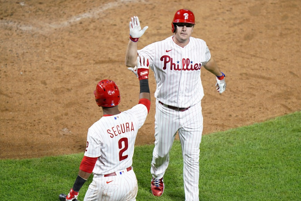 Philadelphia Phillies' Jay Bruce, right, and Jean Segura celebrate after Bruce's home run off Washington Nationals pitcher Max Scherzer during the six...