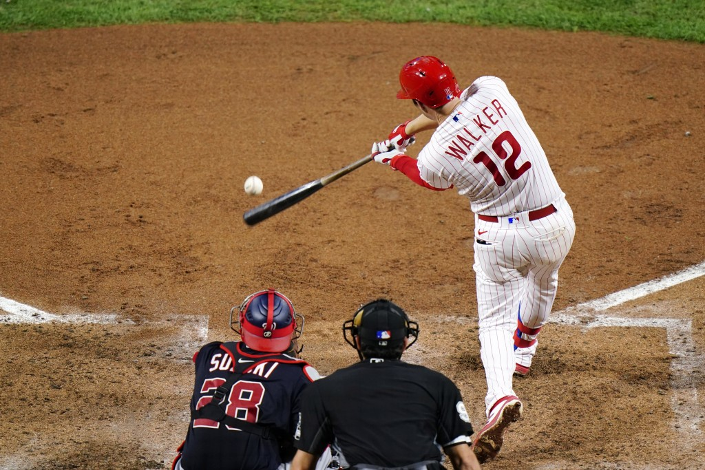 Philadelphia Phillies' Neil Walker hits a two-run single off Washington Nationals pitcher Max Scherzer during the fourth inning of a baseball game, We...