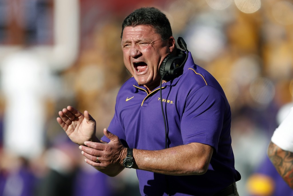 FILE - In this Saturday, Nov. 9, 2019 file photo, LSU head coach Ed Orgeron reacts after a LSU touchdown in the first half of an NCAA football game ag...
