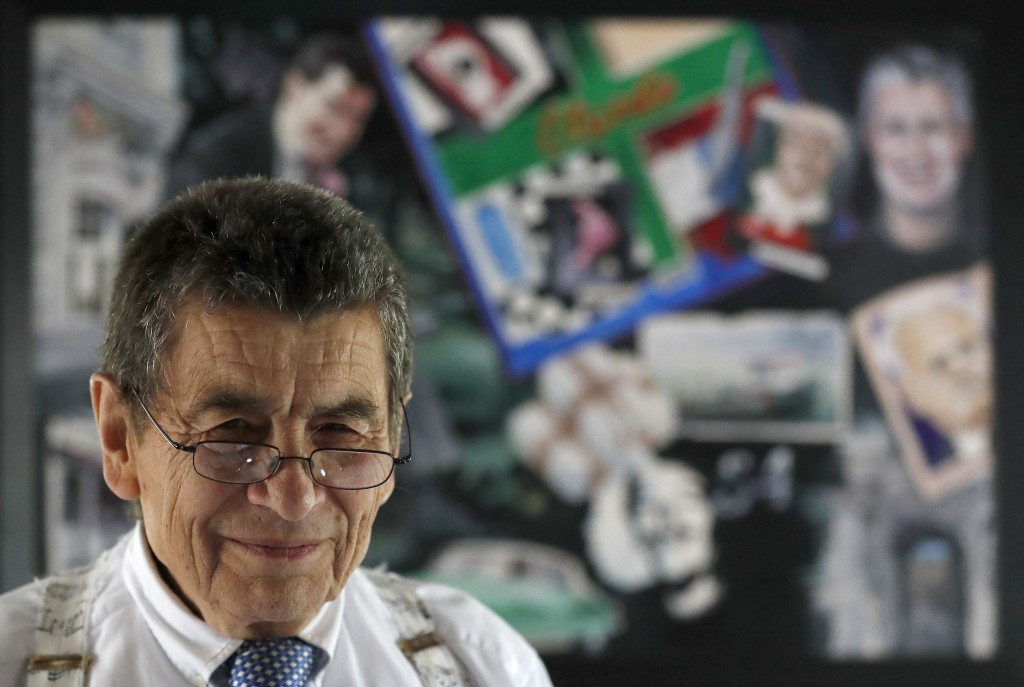 Human rights lawyer Geoffrey Nice stands in front of a picture collage that a friend has done of him at his home in Adisham, England, Wednesday, Sept....