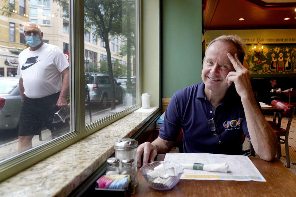 Chicago Alderman Tom Tunney poses inside his main Ann Sather restaurant, Tuesday, Sept. 1, 2020, in Chicago. Tunney estimates he's put $250,000 of his...