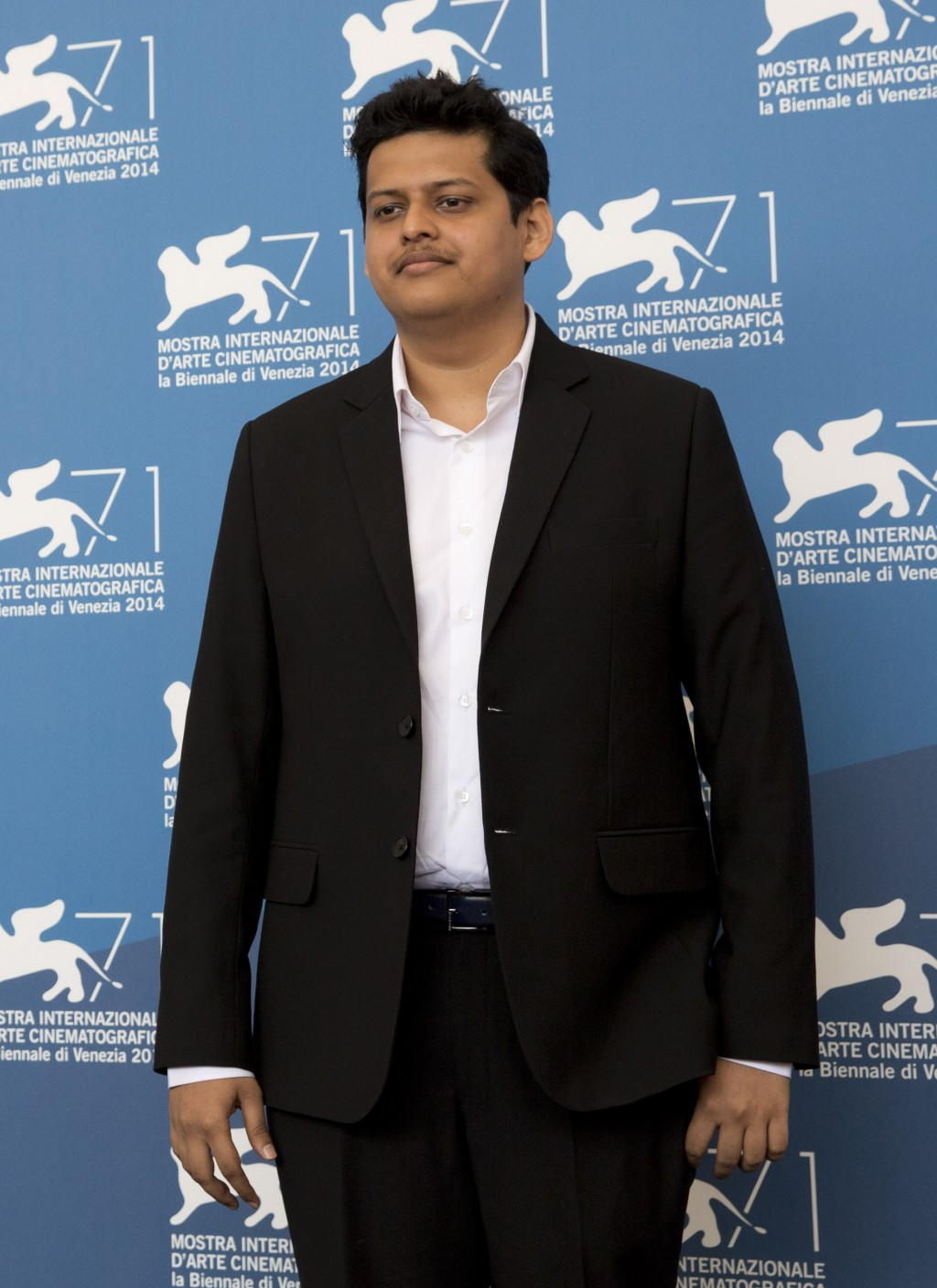 """FILE - Chaitanya Tamhane poses for photographers during a photo call for """"Court"""" at the 71st edition of the Venice Film Festival on Sept. 4, 2014, in ..."""