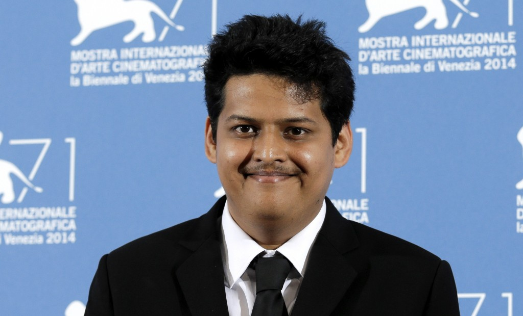 """FILE - Chaitanya Tamhane poses during a photo call for """"Court"""" at the 71th edition of the Venice Film Festival on Sept. 6, 2014, in Venice, Italy. Wri..."""