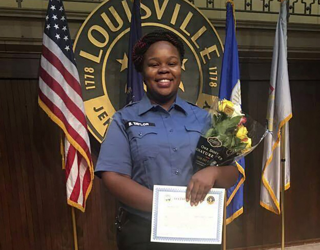 FILE - This undated photo provided by Taylor family attorney Sam Aguiar shows Breonna Taylor in Louisville, Ky.  (Courtesy of Taylor Family attorney S...