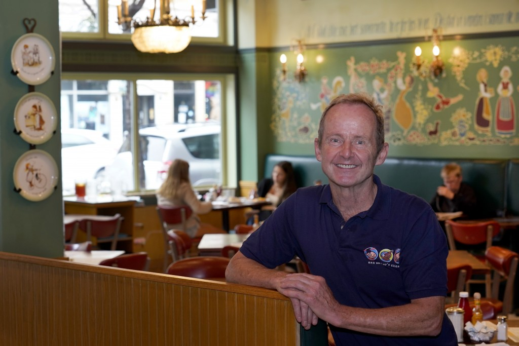 Chicago Alderman Tom Tunney poses inside his main Ann Sather restaurant, Tuesday, Sept. 1, 2020, in Chicago.   Social distancing requirements have cur...
