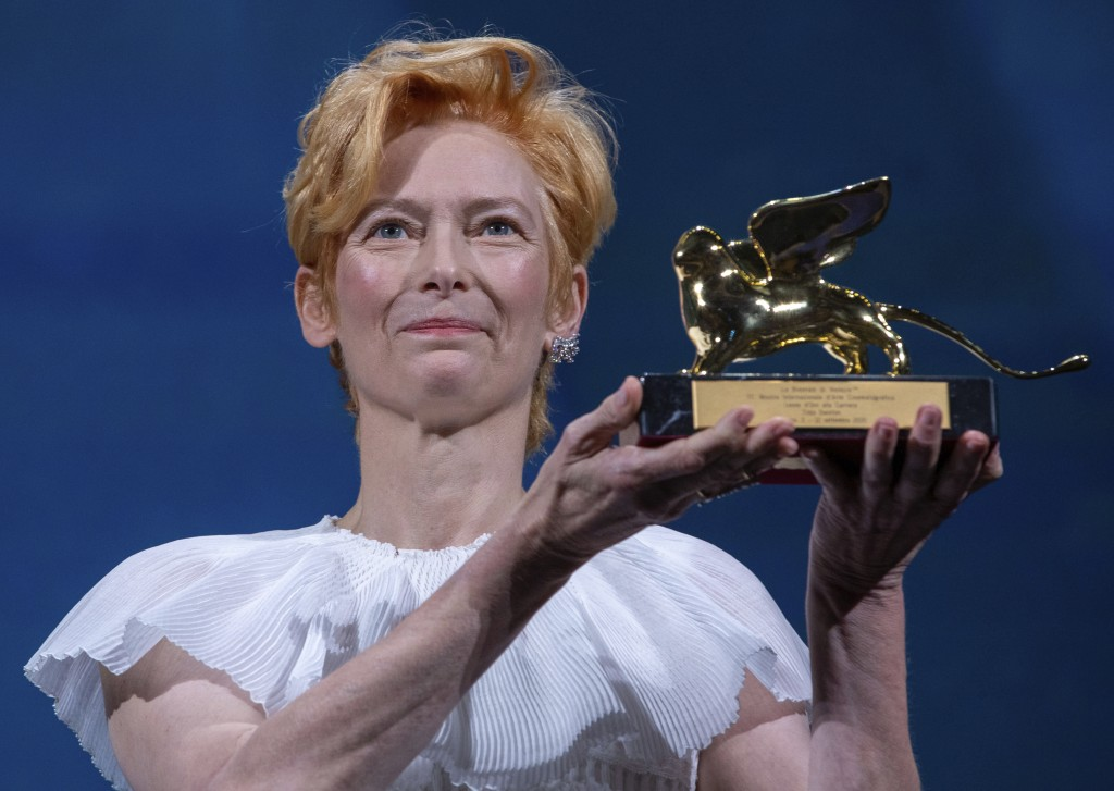 Actress Tilda Swinton holds her Golden Lion For Lifetime Achievement award during the opening ceremony of the 77th edition of the Venice Film Festival...