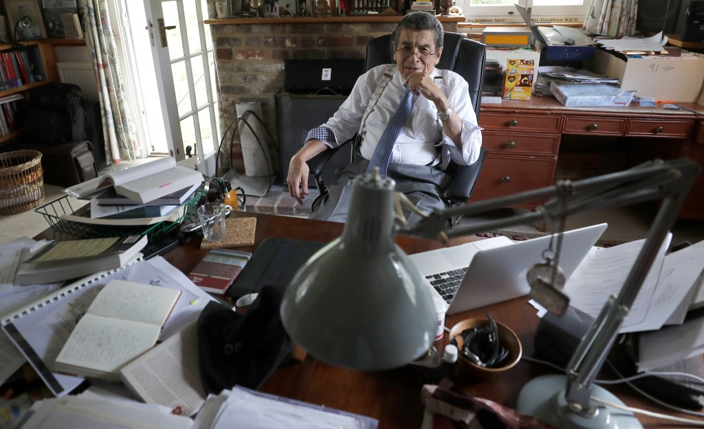 Human rights lawyer Geoffrey Nice sits at his desk at his home in Adisham, England, Wednesday, Sept. 2, 2020. The prominent British human rights lawye...