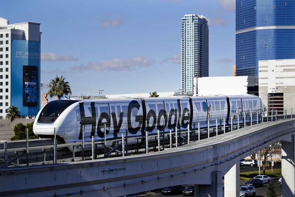 FILE - In this Jan. 10, 2018, file photo, a monorail with a Google advertisement passes the Las Vegas Convention Center during CES International in La...