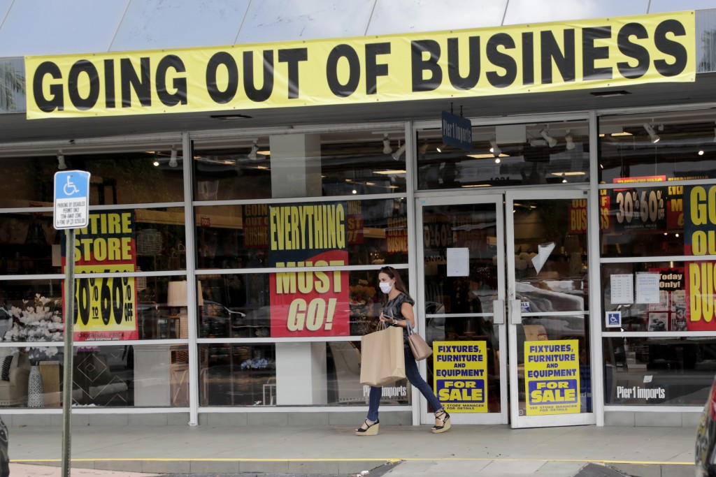FILE - In this Aug. 6, 2020, file photo, a customer leaves a Pier 1 retail store, which is going out of business, during the coronavirus pandemic in C...