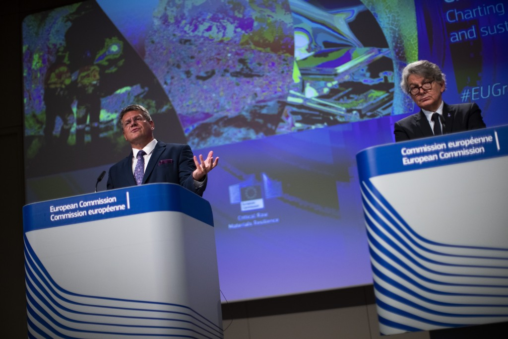 European Commissioner for Inter-institutional Relations and Foresight Maros Sefcovic, left, talks to journalists during an online news conference with...