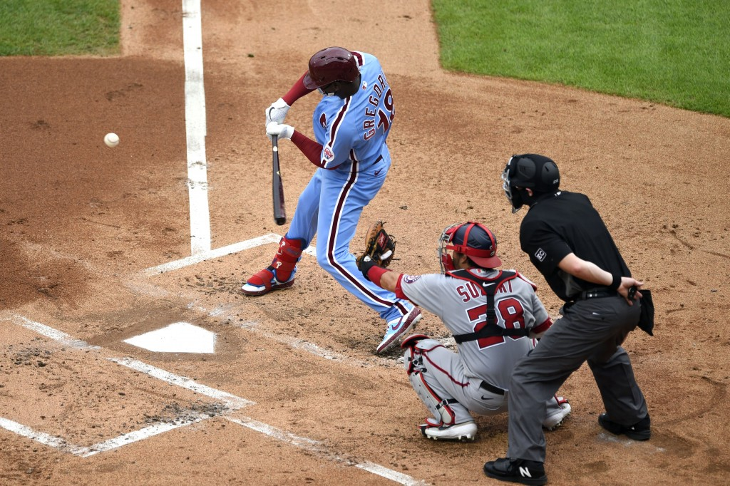 Philadelphia Phillies' Didi Gregorius, left, hits a two-run RBI-single off Washington Nationals' Anibal Sanchez during the first inning of a baseball ...