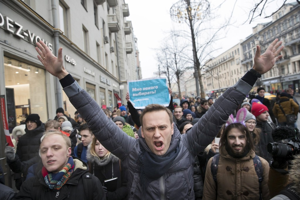 FILE - In this Sunday, Jan. 28, 2018 file photo, Russian opposition leader Alexei Navalny, center, attends a rally in Moscow, Russia. The German gover...