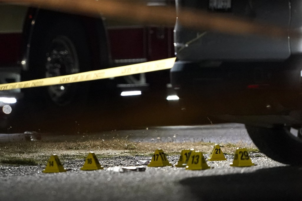 Evidence markers are placed on the ground Thursday, Sept. 3, 2020, in Lacey, Wash. at the scene where Michael Reinoehl was killed Thursday night as in...