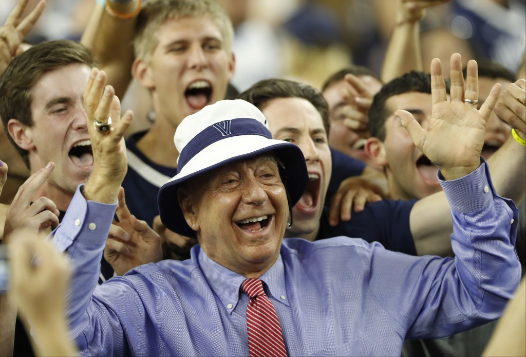 FILE - In this April 4, 2016, file photo, sportscaster Dick Vitale poses with Villanova fans before the NCAA Final Four tournament college basketball ...