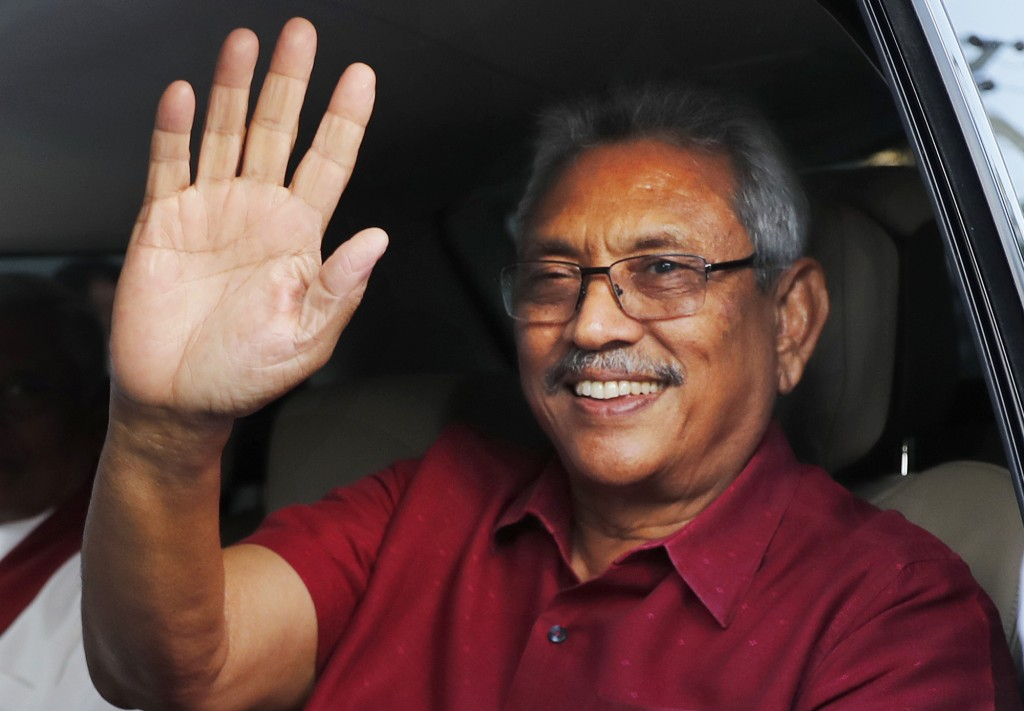 FILE - In this Sunday, Nov. 17, 2019, file photo, Sri Lankan President-elect Gotabaya Rajapaksa waves to supporters as he leaves the election commissi...