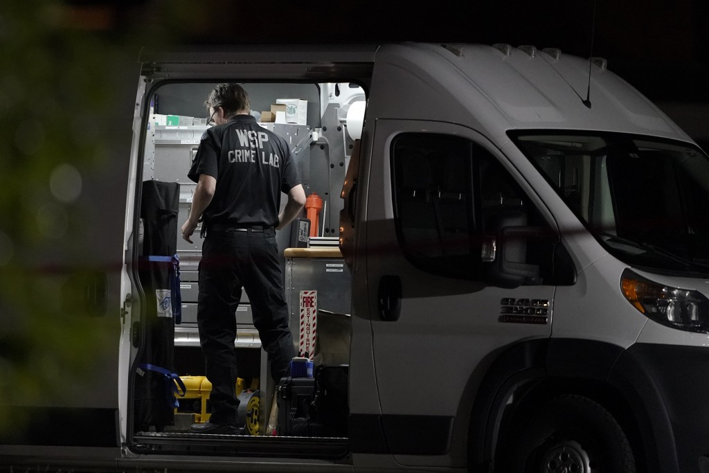 A Washington State Patrol Crime Lab worker stands in a van, Thursday, Sept. 3, 2020, in Lacey, Wash. at the scene where Michael Reinoehl was killed Th...