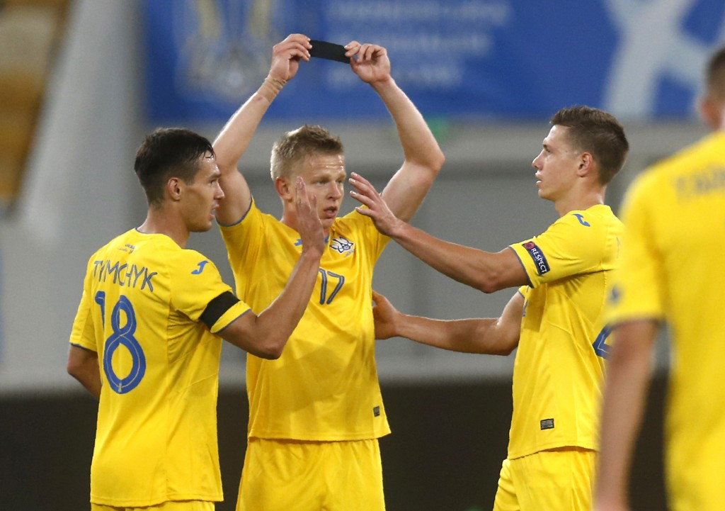 Ukraine's Olexandr Zinchenko, centre, celebrates with teammates after scoring his side's second goal during the UEFA Nations League soccer match betwe...
