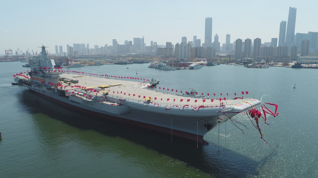 FILE - In this April 26, 2017, file photo released by China's Xinhua News Agency, a newly-built aircraft carrier then unnamed is transferred from dry ...