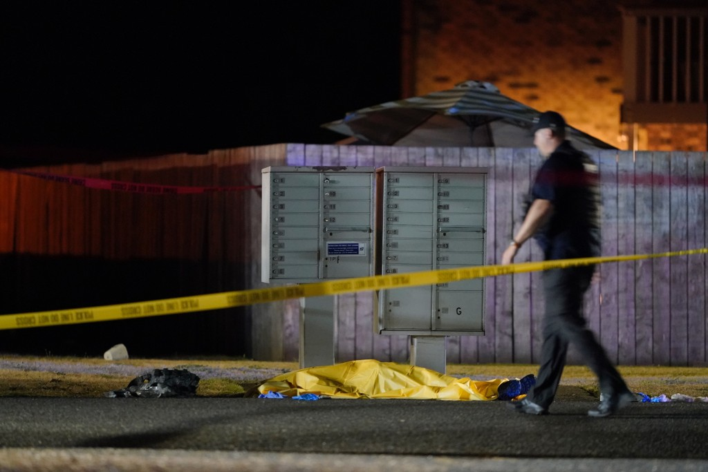 Officials work at the area late Thursday, Sept. 3, 2020, in Lacey Wash., where a man suspected of fatally shooting a supporter of a right-wing group i...
