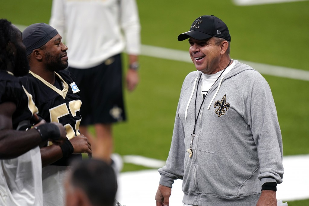 New Orleans Saints head coach Sean Payton laughs with players during NFL football practice in  New Orleans, Thursday, Sept. 3, 2020. (AP Photo/Gerald ...