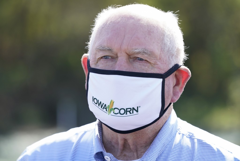 Agriculture Secretary Sonny Perdue tours a CREP wetland structure on the Heath Stolee farm, Thursday, Sept. 3, 2020, in Radcliffe, Iowa. (AP Photo/Cha...