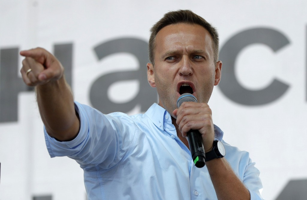 FILE - In this July 20, 2019, file photo, Russian opposition activist Alexei Navalny gestures while speaking to a crowd during a political protest in ...