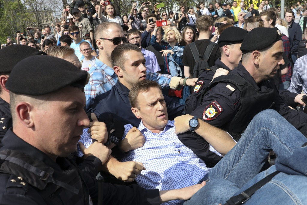 FILE - In this May 5, 2018, file photo, Russian police carry opposition leader Alexei Navalny, center, from a demonstration against President Vladimir...