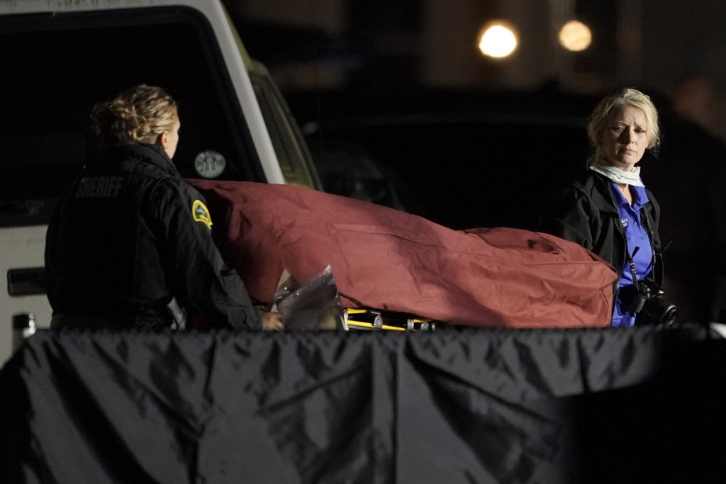 The body of Michael Reinoehl is taken away on a stretcher in the early morning hours of Friday, Sept. 4, 2020, in Lacey, Wash. Reinoehl was killed Thu...
