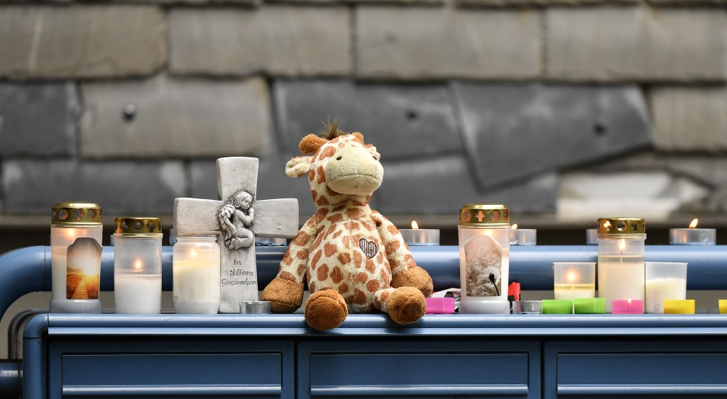 Toys and candles are set on the mailbox of an apartment building where five dead children were found in Solingen, Germany, Friday, Sept. 4, 2020. Poli...