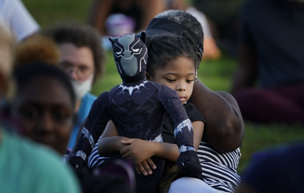Khloe Murray, 5, of South Carolina, holds her Black Panther doll during a Chadwick Boseman Tribute on Thursday, Sept. 3, 2020, in Anderson, S.C. (AP P...