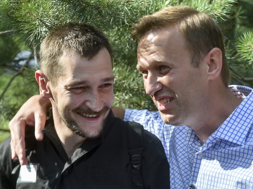 FILE - In this June 29, 2018, file photo, Russian opposition leader Alexei Navalny, right, embraces his brother, Oleg Navalny, center, after Oleg was ...