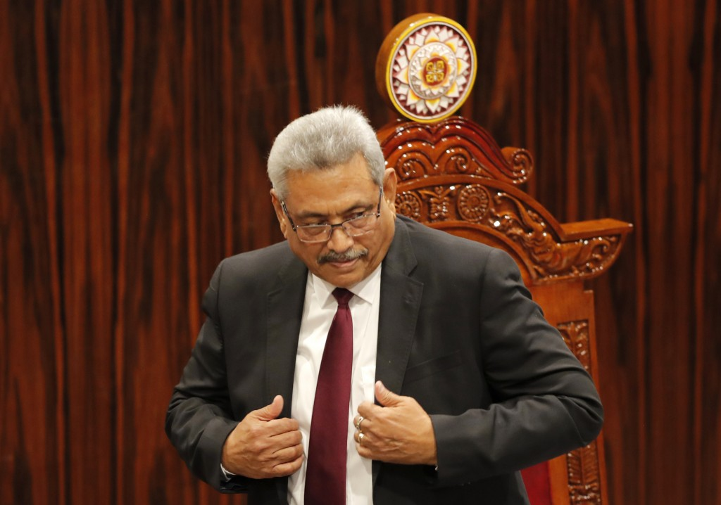 FILE - In this Friday, Jan. 3, 2020, file photo, Sri Lankan President Gotabaya Rajapaksa leaves after addressing parliament during the ceremonial inau...