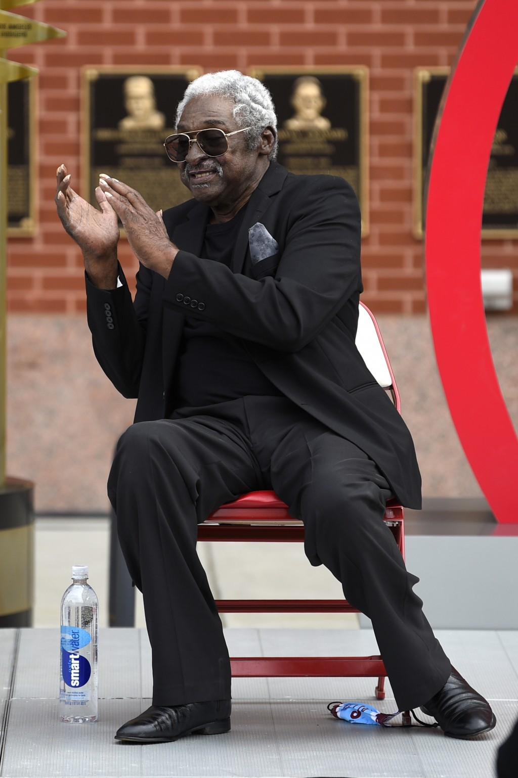 Former Philadelphia Phillies player Dick Allen reacts after a ceremony at the unveiling of his retired number prior to a baseball game between the Phi...