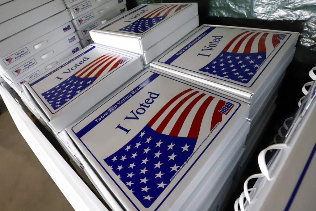 FILE - In this June 1, 2020, file photo a stack of table top voting booths are stored at the Allegheny County Election Division's warehouse on the Nor...