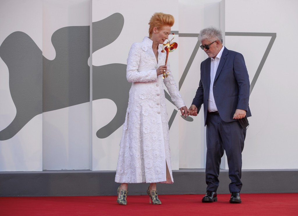 Director Pedro Almodovar, right, and actress Tilda Swinton pose on the red carpet of the movie 'The human voice' during the 77th edition of the Venice...